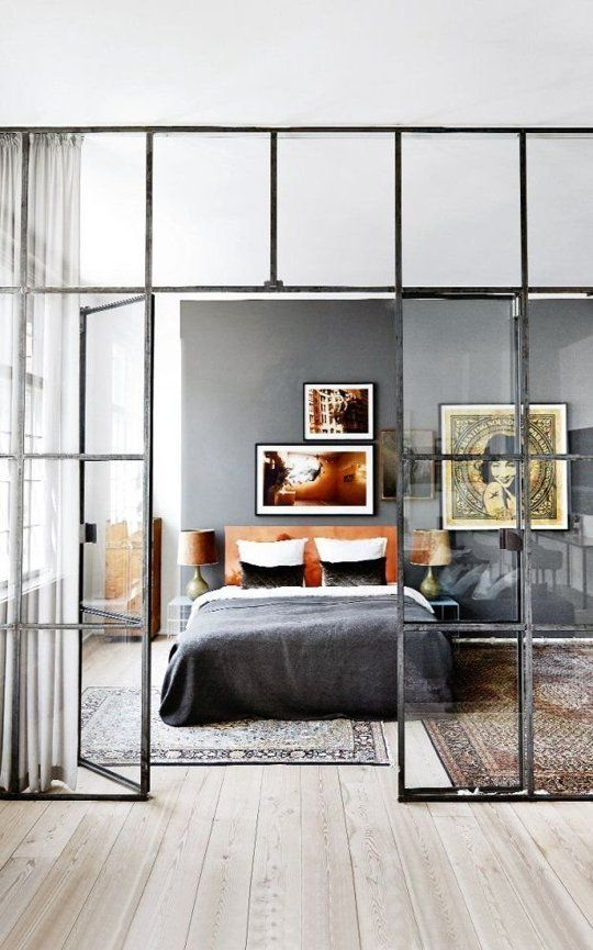 """Beautiful and Practical: Windows Indoors. """"A glass divider keeps this apartment, from Dom & Wnetrze via Domaine Home, feeling airy and spacious. The curtain behind the divider can be drawn for a little extra privacy."""""""
