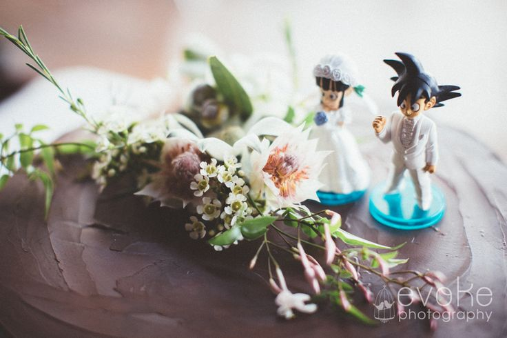 Goku and Chi Chi wedding cake toppers on Mexican Chocolate Cake with Native Australian Flowers