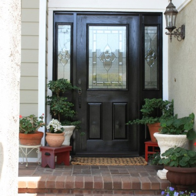 35 front door flower pots for a good first impression black front doors paneling painted and for Black exterior door with sidelights
