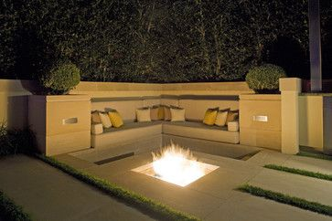 Sleek sunken fireplaces hide out of sight with a grate or panel when you are not using it.