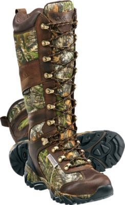 Battle through the challenges of snake country in our Lace-Up Snake Boots. Ultradurable full-grain waxed-leather uppers have been tested against some of the most venomous serpents, and their fangs were unable to penetrate the reliable Snake Guard® Extreme barriers. Imported.  Women's sizes:  6-10 medium width. Half sizes to 10.  Camo pattern:  Mossy Oak® Obsession®.