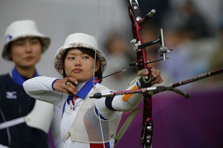 Japan's Kaori Kawanaka lets fly a bronze-winning arrow in the women's Team Archery match at Lord's Cricket Ground on Day 2 of London 2012