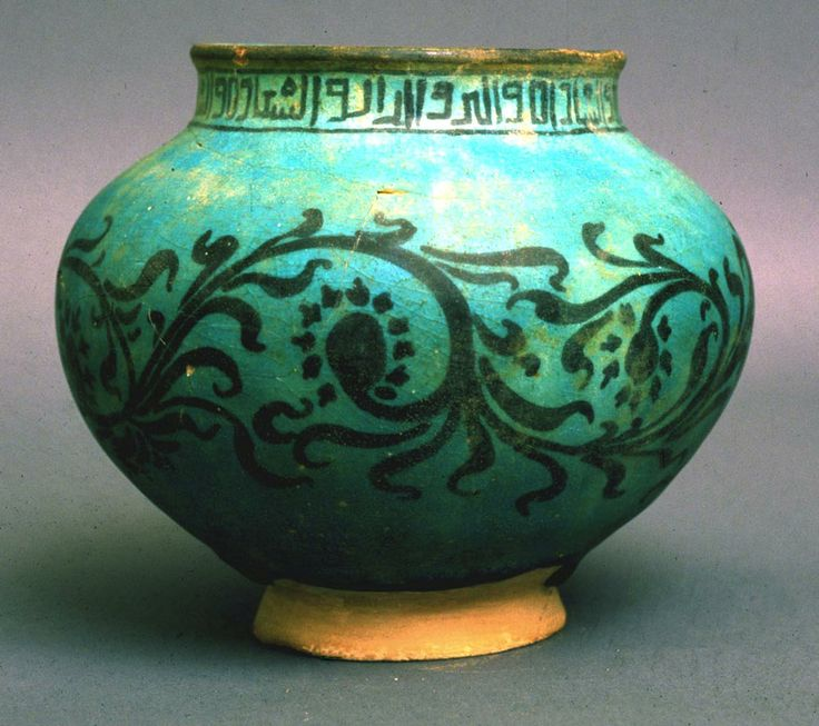 Kashan Vase Persian Il-Khanid Period c. 1260 CE Wheel thrown ceramic 14 cm tall Skyline Museum Iranian luster and under-glaze ceramics continued in the Kashan area after Mongol invasion. Its a continuing tradition marked by distinctive blue glaze obtained from turquoise. Decorated in traditional Islamic method using only geometric forms, arabesque patterns, and inscriptions. Gift of Drs. John and Bessie Sawhill