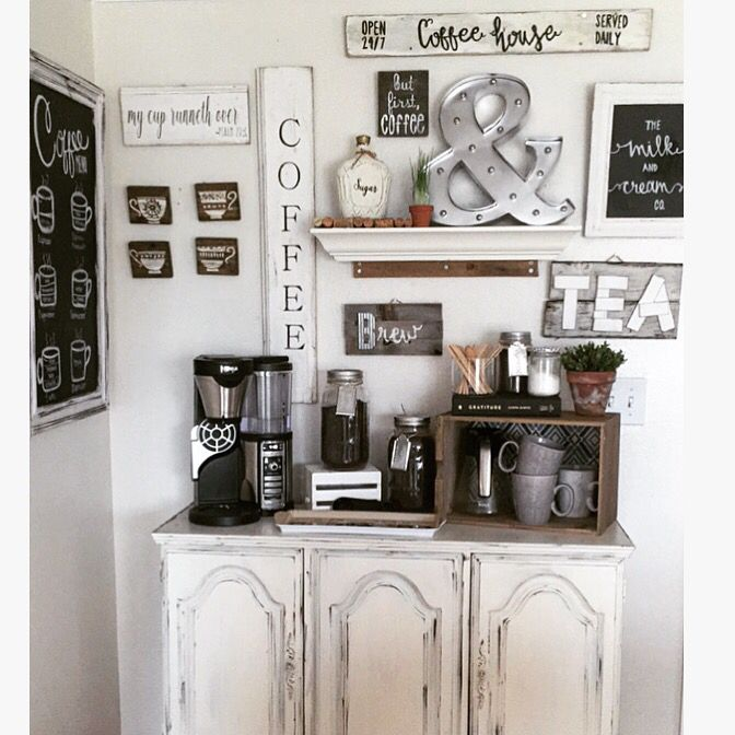 Coffee bar made from an old china cabinet bottom with all handmade signs.