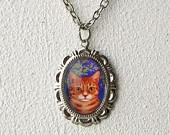 Grumpy Cat antique copper necklace. $9.60, via Etsy.
