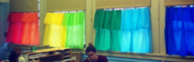 Easy classroom curtains using party store plastic table clothes. No rod necessary - hang from rope of existing classroom shade  using clothing pins  courtesy of stacy rosen classroom design!