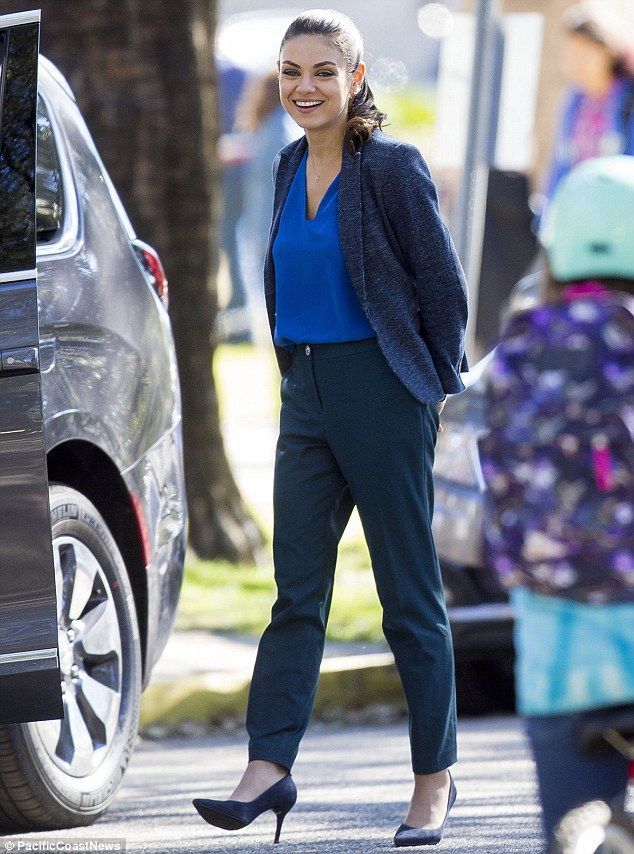 Mamma mia!: Mila Kunis looked glamorous on the set of her Bad Moms comedy in New Orleans, Louisiana on Wednesday
