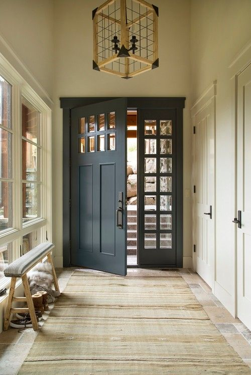 navy front door interior | rustic decor | farmhouse chic | wood light fixture | entry bench | home decor | interior design