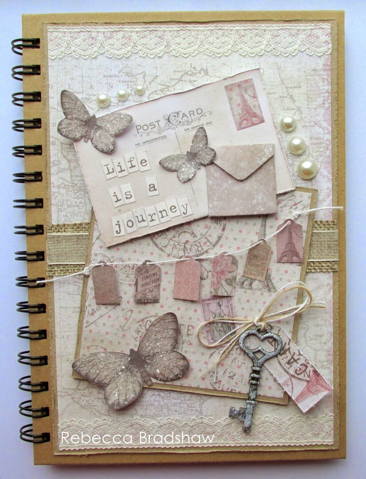 A journal decorated with papers and elements from the Correspondence collection