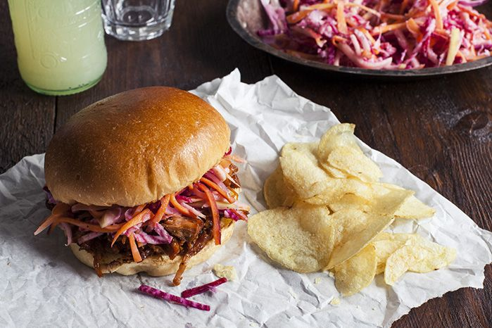 BBQ pulled pork in toasted brioche bun with crunchy beetroot slaw