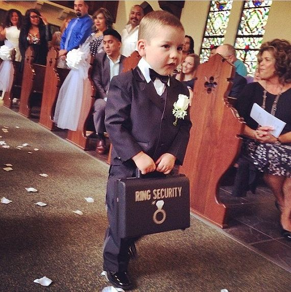 ✦This listing is for one RING SECURITY BRIEFCASE✦ Let your ring bearer guard the bling with this cute ring security briefcase. ✦ Each case is constructed from a heavy duty polypropylene with integrated latches and handle ✦It is the perfect accessory and keepsake for any Ring Bearer or Ring Security Agent! ✦See photo (4 & 5) for briefcase dimensions (10.69 x 9.52 x 3.36) & (14.13 x 11.95 x 2.95) The bigger case would work best for a taller child...over 10 years old.