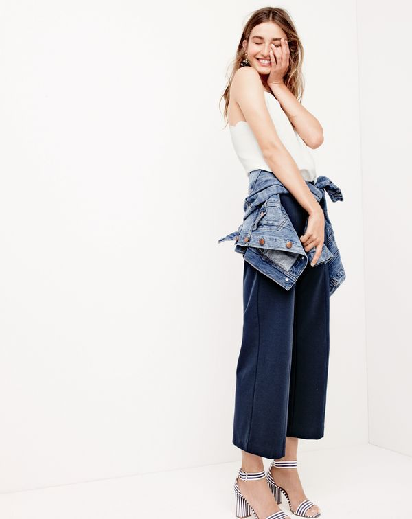 J.Crew women's scalloped Carrie cami, denim jacket in Tyler wash, wide-leg ponte pant,  tortoise and crystal earrings and striped strappy high-heel sandals.