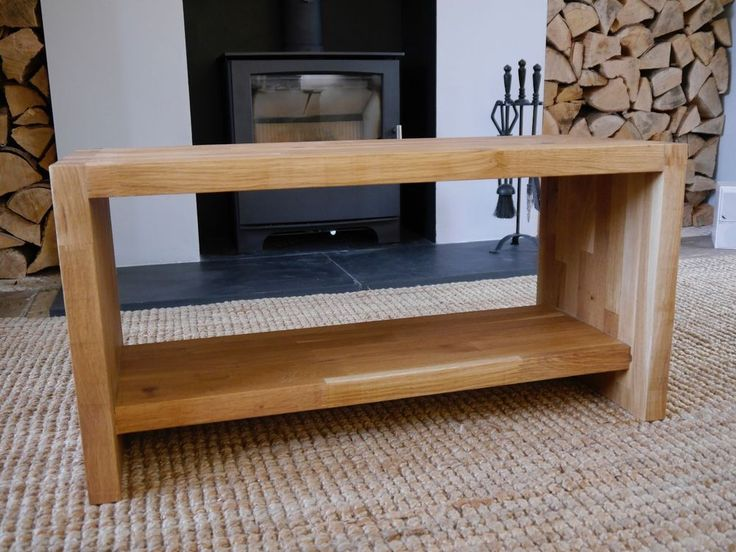 For sale, a unique and hand made solid oak bench or coffee table. Handmade by me in Kent this piece is made from 40mm thick engineered oak sheet featuring chunky dovetail joins and a useful underslung storage shelf.   eBay!