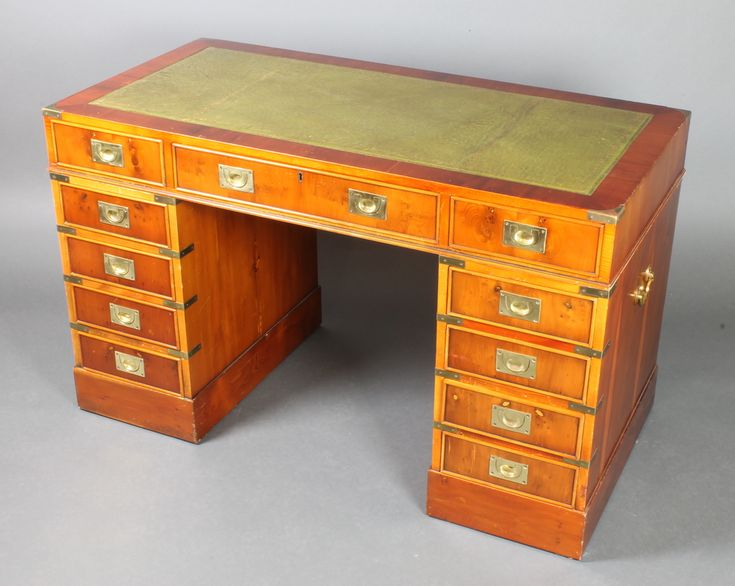 "Lot 946, A Victorian style yew Military desk with green inset writing surface above 10 short drawers, fitted 1 long drawer with brass carrying handles to the sides 29 1/2""h x 48""w x 24""d, sold for £440"