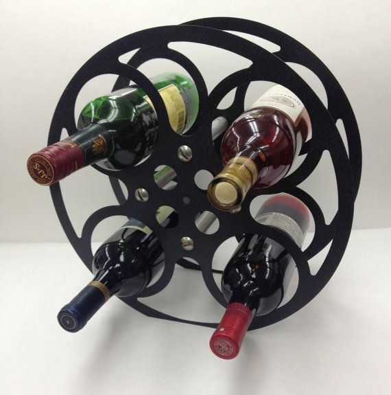 17 best images about uses for old film reels on pinterest for Movie reel wine rack