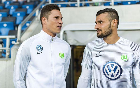 Julian Draxler of VfL Wolfsburg and Daniel Caligiuri of VfL Wolfsburg during the DFB Cup match between FSV Frankfurt and VfL Wolfsburg at Frankfurter...