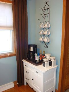 Cute coffee station! Bottle holder for coffee cups. Or is that a towel holder? Whatever it is, it's Cute!