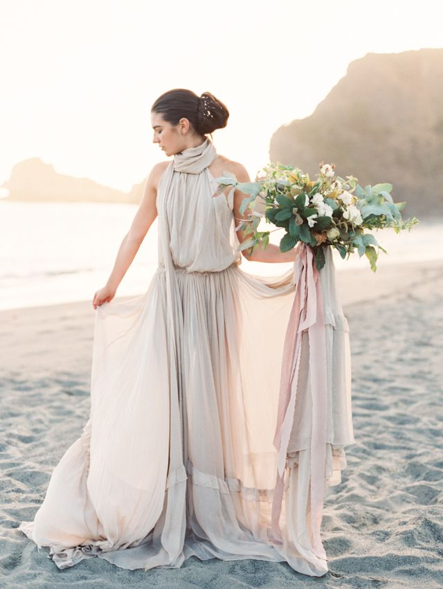 Beautiful draped wedding gown | Kylie Martin Photography via @burnettsboards