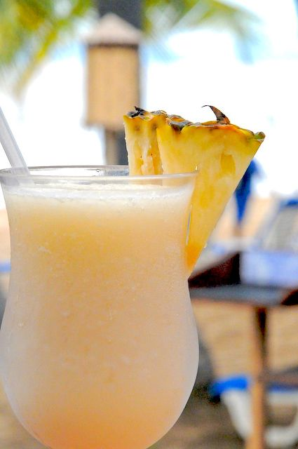 Pina Colada: 3 oz. light Rum, 6 oz pineapple juice, 2 ounces coconut cream, 2 cups ice, pineapple spears In blender combine rum, pineapple juice, coconut cream and ice. Blend until all ingredients combined. Garnish with pineapple spears. A cherry and an umbrella :D