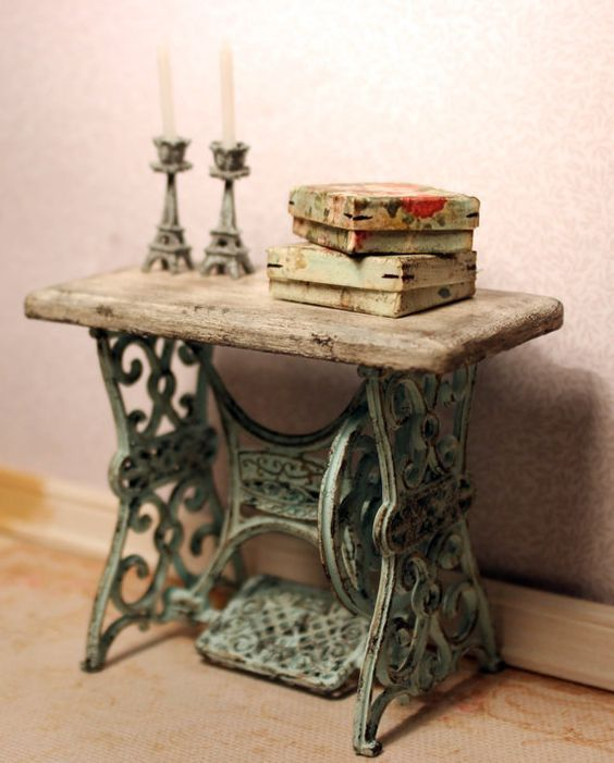 Sewing base w/reclaimed wood taop candlesticks books
