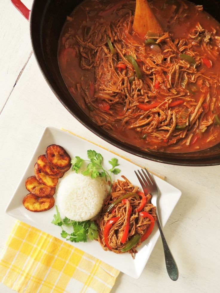 "Ropa vieja Cubana (Cuban Shredded beef). Discover Ropa vieja, Spanish for ""old clothes,"" is a shredded flank, brisket, or skirt steak in a tomato sauce base."