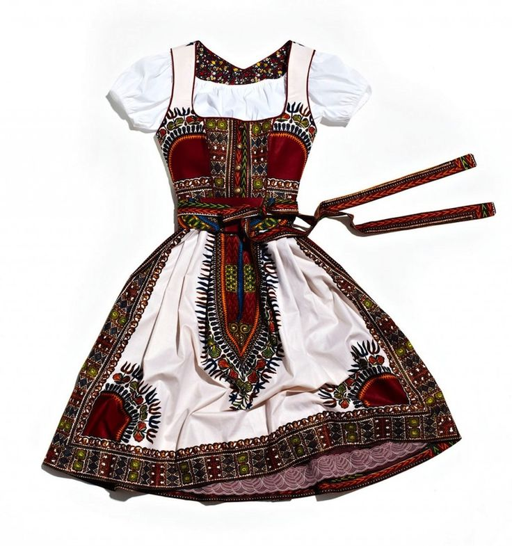 A very successful marriage of the traditional looks of two nations: Dirndl á l'Africaine. #African #ethnic #print #dirndl #dress #folk #costume #German #clothing