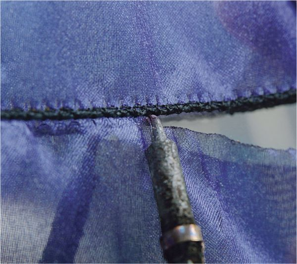 How to Easily Hem Sheer Fabrics - Threads >Nice finish! >Easy to follow instructions & photos >Must use rayon thread if clean cutting or use electric razor (cool idea!)