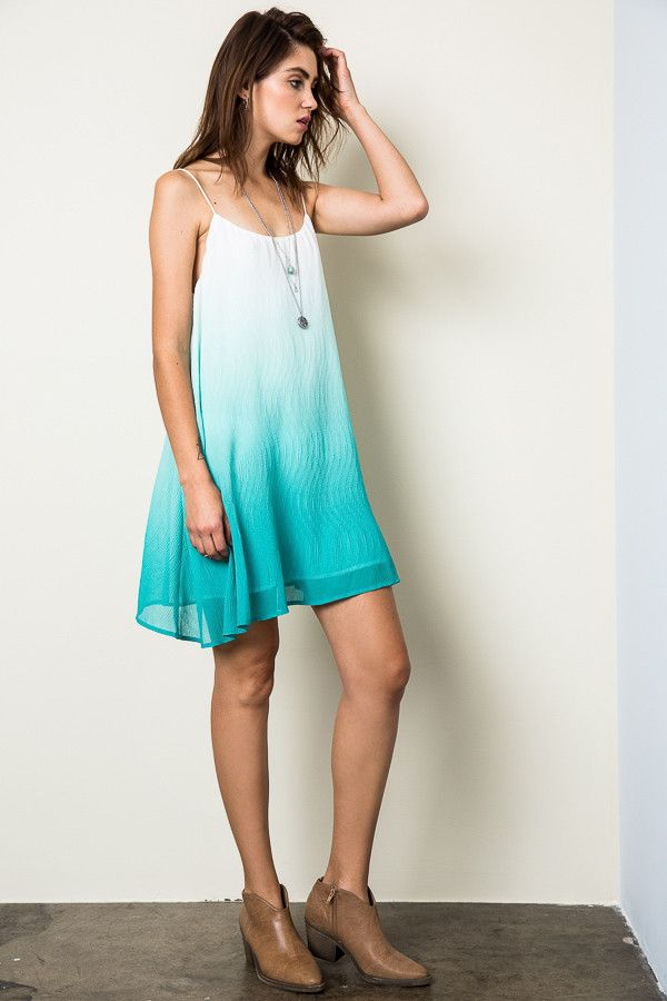 Super cute, comfortable, and loose fit knit ombre knit dress with embroidered front detail.