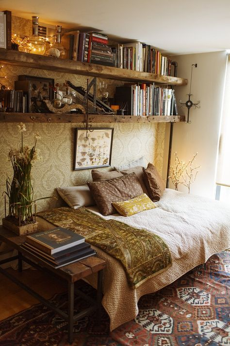 Love the high book shelf idea. Especially the deep wood texture.