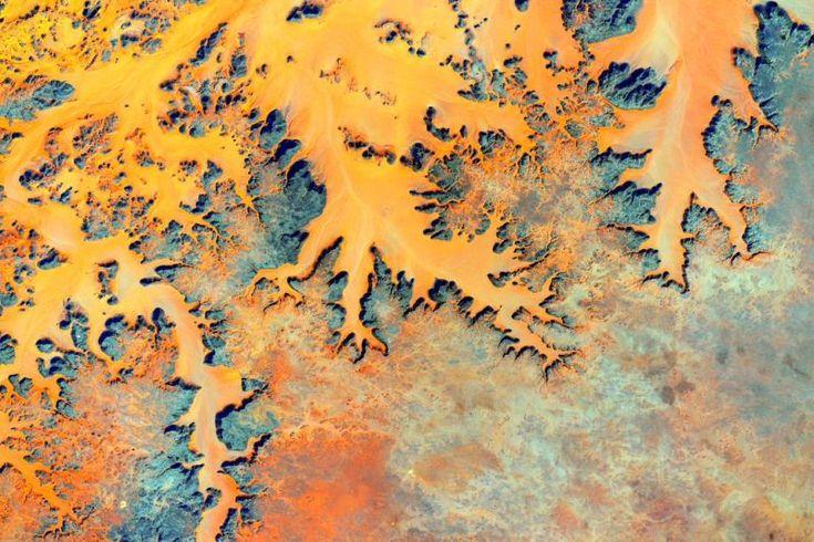 September 6, 2015: Sediment tints rivers to a rich, deep orange. Image credit: NASA/Scott Kelly