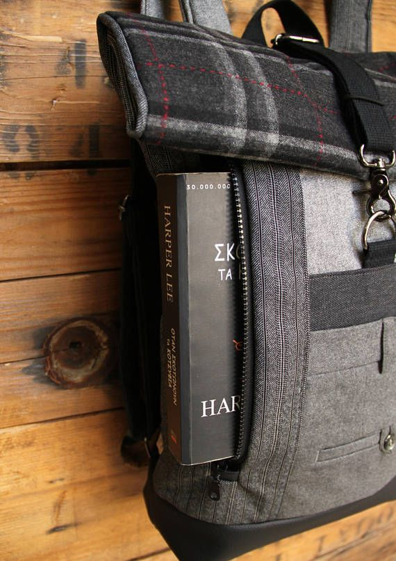 Gray roll top upcycled rucksack using part from a gray men's trousers to create a double pocket on the front, by 'eating the goober'