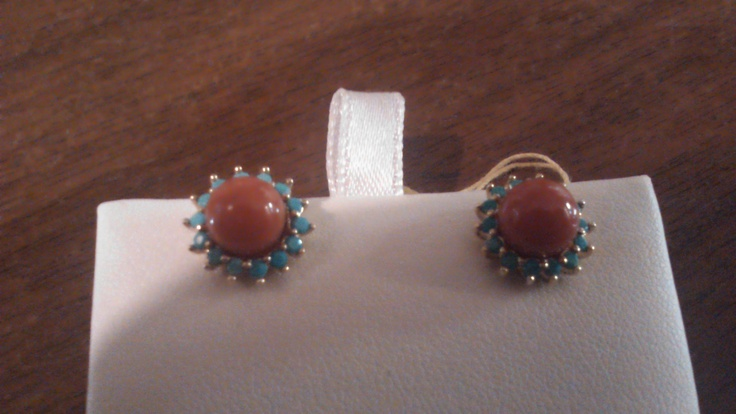 Coral and turquoise earrings on a 14k yellow gold mounting.