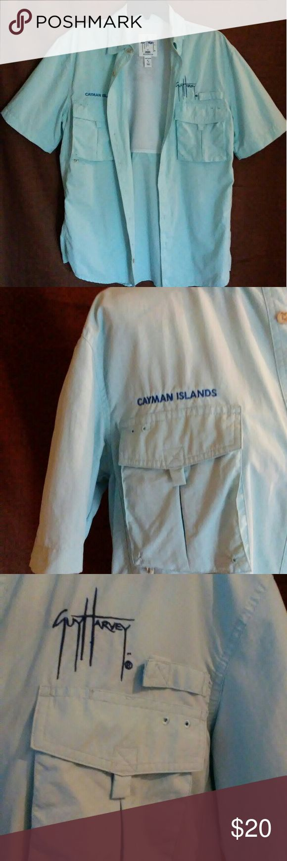 GUY HARVEY. FISHERMEN  BUTTON UP Like new light blue fishing shirt. Helps keep you cool in the heat. Button up with 2 front pockets. Guy Harvey Shirts Casual Button Down Shirts