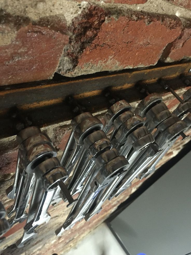 """Wrench rack made from 1"""" angle and 16d nails."""