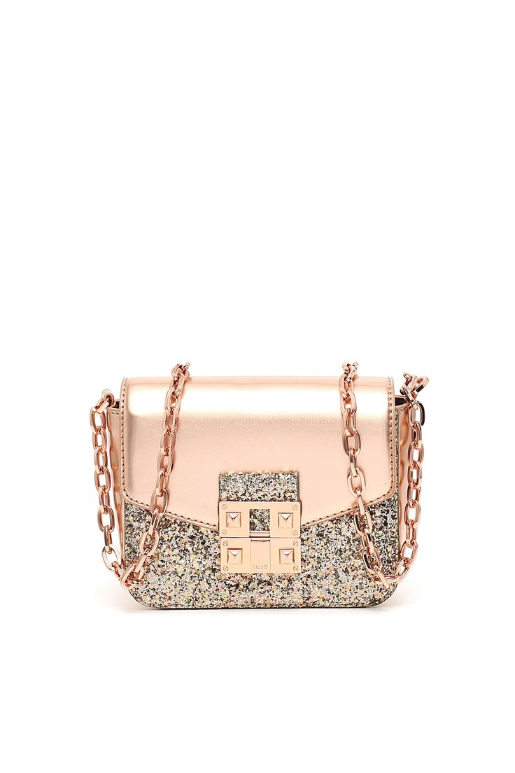 Faux leather crossbody bag wtih 'aurora borealis' effect GLITTER, chain shoulder strap and snap closure in silver metal with pyramid studs.  IRRESISTIBLE and ULTRA GLAM accessory perfect for your exclusive PARTIES or for going out to dinner with friends.