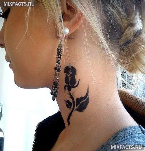 татуировка роза черная на шее