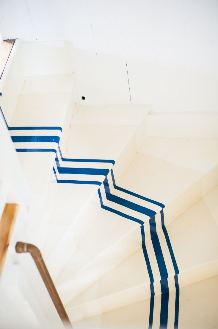 DIY Nautical Paint Navy Stripes on Stairway! check out this blog to see step by step (literally) how to paint stripes on your stairway! We recently caught up with Joseph M. Palmieri, paint decorator extraordinaire, to find out how to apply shipshape order to wooden stairs.