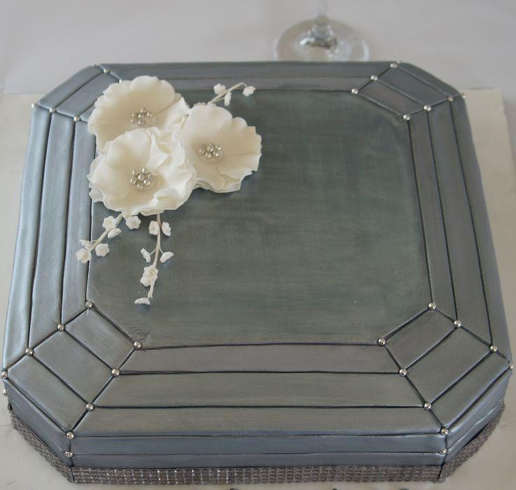 Silver and white wedding cake. For more wedding flower designs please go to www.naomijones.com.au.