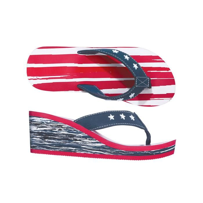 """Patriotic Wedge Flip Flop. Spring fling! Goodbye winter and hello spring! Kick off the season with your American pride and strut your stuff with these casual wedged flip-flops.    FEATURES  • Wedge flip-flip with a patriotic red, white, and blue design  • Blue toe strap with white studded stars and white stitching  • Red and white striped footbed  • Red trim around blue and white patterned wedge  • Run true-to-size  • Bottom of the soles are skid-resistant  • Height of heel: 2 1/4"""""""