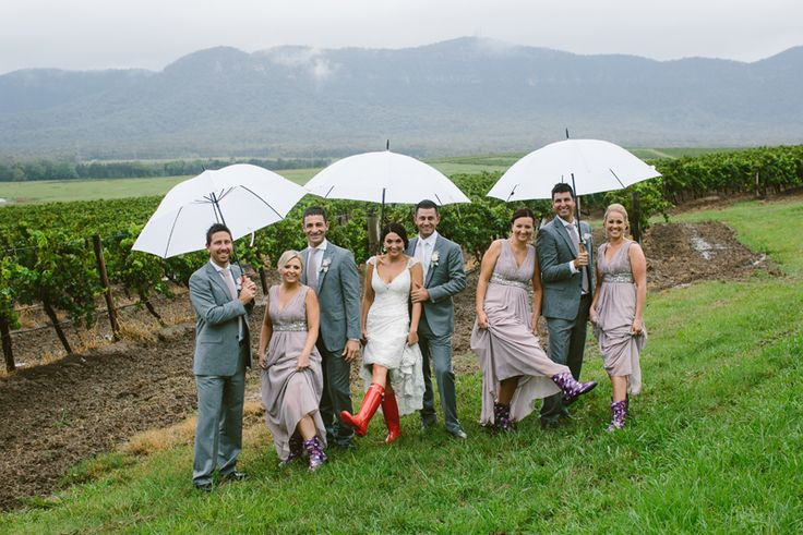Wet weather wedding photos. Gumboots for the girls. Hunter Valley wedding. Image: Cavanagh Photography http://cavanaghphotography.com.au