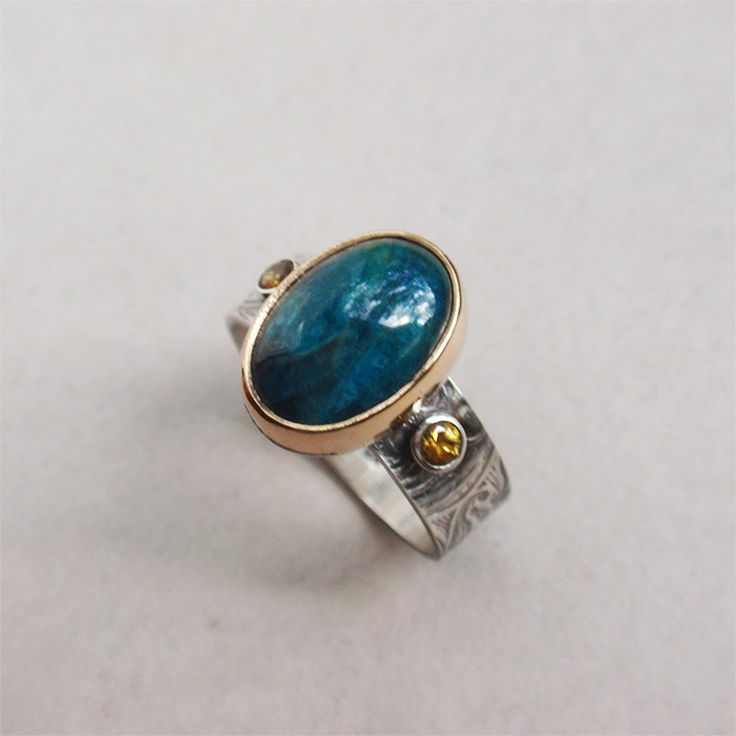 Patterned sterling silver ring with apatite cabochon and faceted yellow sapphires