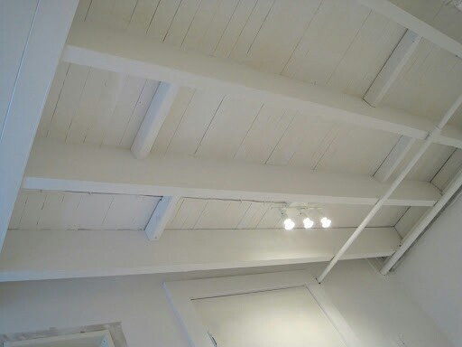 DIY UNFINISHED BASEMENT. Gleaming white ceiling.