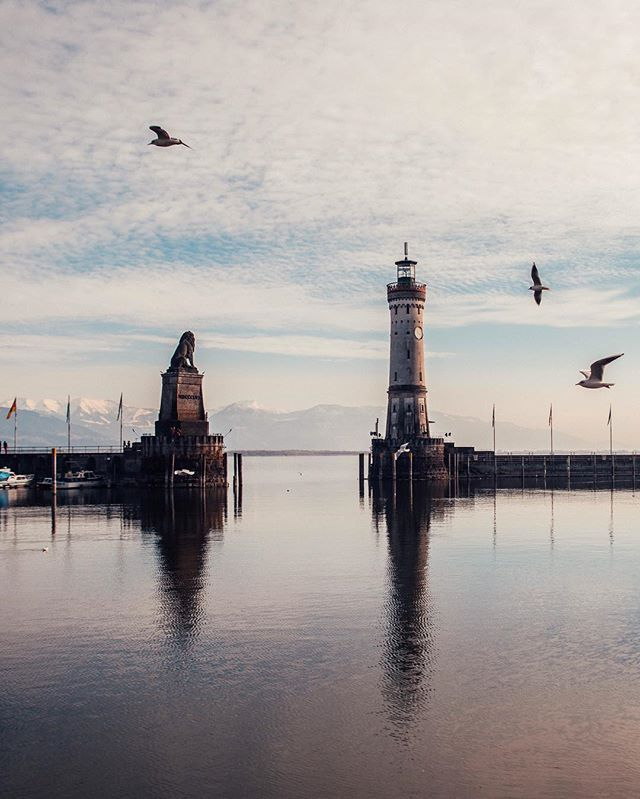Another beautiful place we found around #Alps was the magnificent city of #Lindau (#Germany). A city built on island in the Lake Constance is famous for its unique harbor, where the entering ships are greeted by a lighthouse and the Bavarion Lion! Interestingly, though Lindau's history dates back to 9th century, these two objects were built only in the mid-19th century. Nonetheless, this harbor is another amazing object in #Bavaria region and a spectacular landmark to gaze upon! ❤…