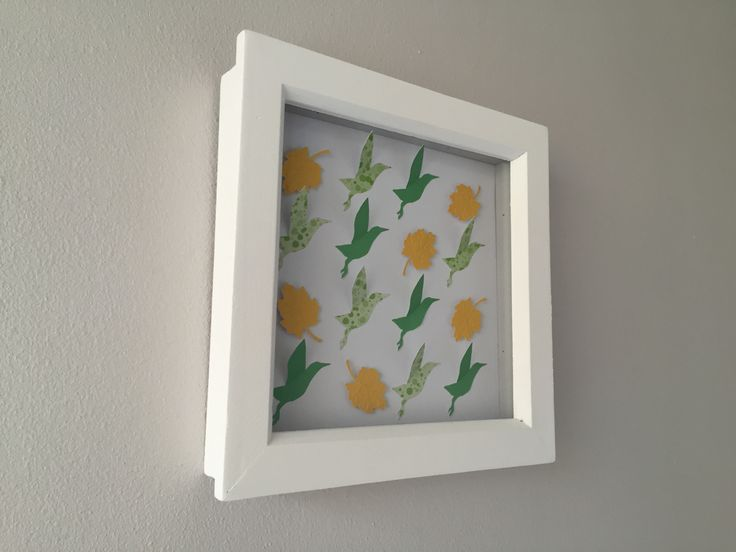 """Frame dimensions - 6""""x6"""" (15.2cm x 15.2cm)Colours - Birds in mid green and apple green spots with yellow leaves on a white background (PC4, RD5, CL6)Stunning hand crafted leaf and bird framed art. Each leaf in individually embossed with veins to add interest and is raised to create a beautiful 3D effect. Every starling is cut with a blade and then each wing is hand folded. No two starlings are therefore ever exactly the same. Choose this colour scheme or someth..."""