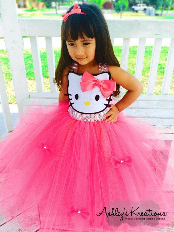 Hello Kitty Tutu Dress by ShopAshleysKreations on Etsy and like OMG! get some yourself some pawtastic adorable cat shirts, cat socks, and other cat apparel by tapping the pin!