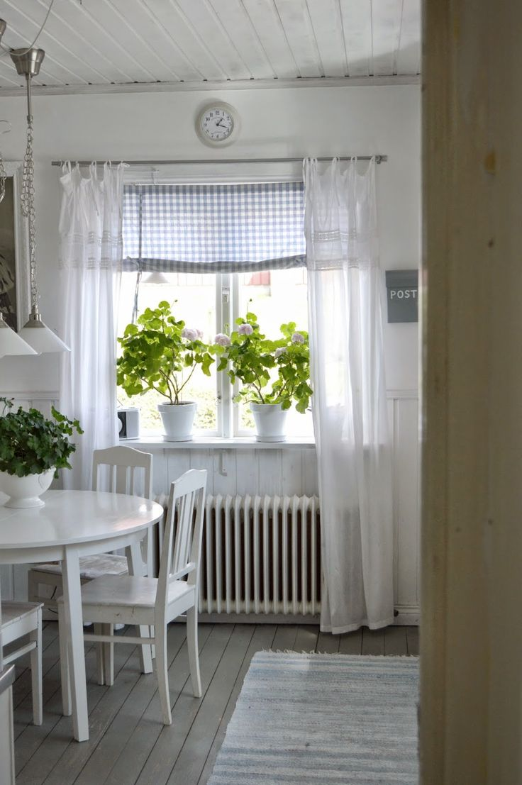 Clean & White - I love the blue gingham and white fabrics in the windows, and the plants.