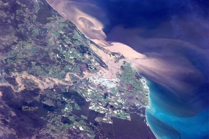 Canadian astronaut, Commander Chris Hadfield, photographed the 2013 Queensland floods while passing over central Queensland in the International Space Station. Here's what he tweeted: @Cmdr_Hadfield: You can see the floodwaters pouring straight through Bundaberg and into the ocean. Keep safe and dry down there!