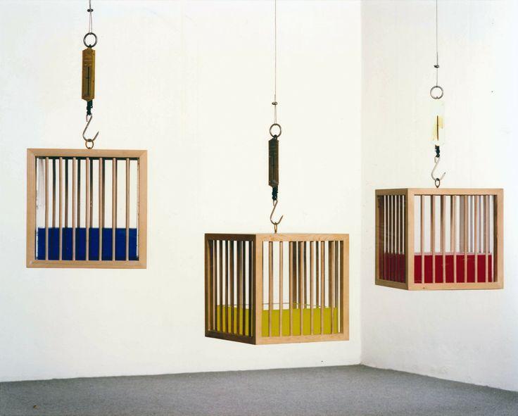 Fabrizio Plessi, Gabbie d'acqua, 1972, 37x37x37 cm (ciascuna), Scultura oggetto in legno, perspex con un sistema di misura del peso e acqua di 24 colori diversi (monotipo) - See more at: http://www.tripartadvisor.it/fabrizio-plessi-mostra-mudima-milano/