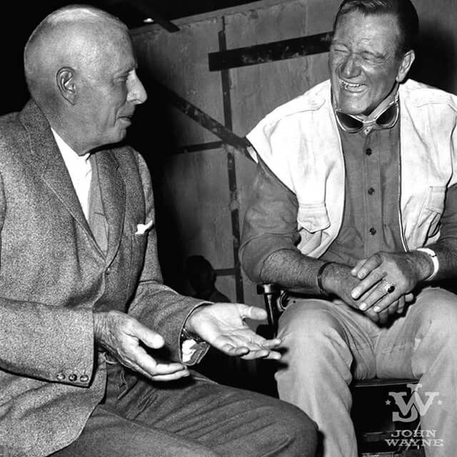 """""""If you don't get a damn good actor with [John Wayne], he's going to blow him right off the screen, not just by the fact that he's good, but by his power, his strength,"""" Howard Hawks said about John Wayne in the book Hawks on Hawks.  Photo: Howard Hawks and John Wayne laugh it up on the set of Hatari! (1962)."""