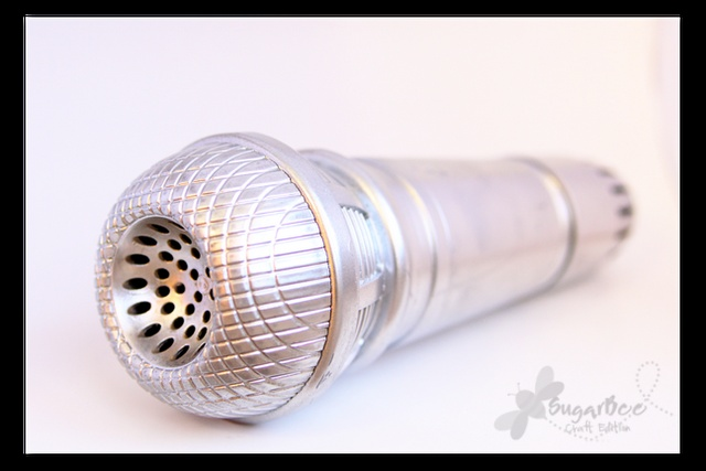 spray painted $1 kid's toy microphone.